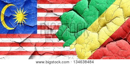 Malaysia flag with congo flag on a grunge cracked wall