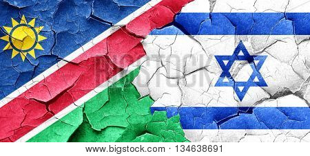 Namibia flag with Israel flag on a grunge cracked wall