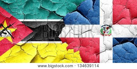Mozambique flag with Dominican Republic flag on a grunge cracked