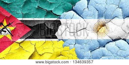 Mozambique flag with Argentine flag on a grunge cracked wall