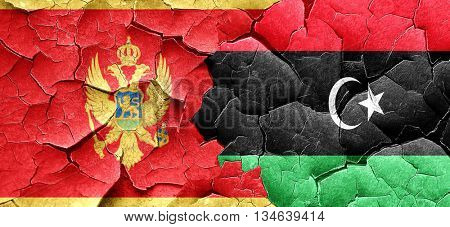 Montenegro flag with Libya flag on a grunge cracked wall