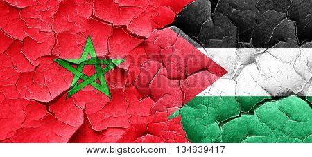 Morocco flag with Palestine flag on a grunge cracked wall