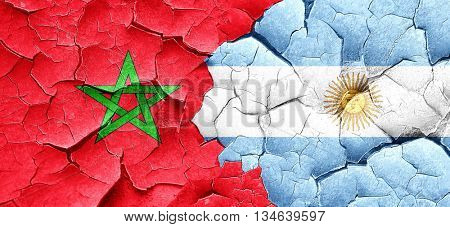 Morocco flag with Argentine flag on a grunge cracked wall