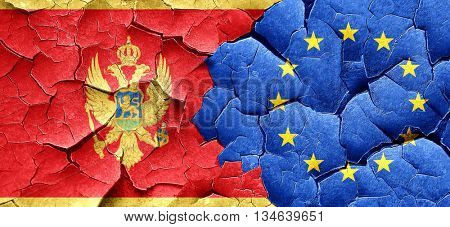 Montenegro flag with european union flag on a grunge cracked wal