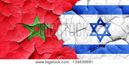 Morocco flag with Israel flag on a grunge cracked wall