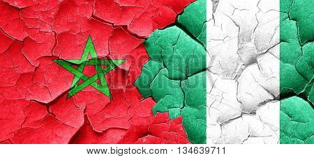 Morocco flag with Nigeria flag on a grunge cracked wall
