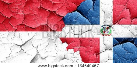 monaco flag with Dominican Republic flag on a grunge cracked wal