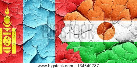 Mongolia flag with Niger flag on a grunge cracked wall