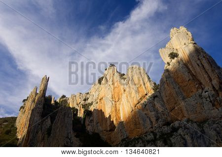 rocky needles and cloudy sky in Spain.