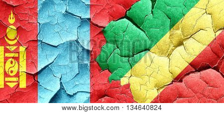 Mongolia flag with congo flag on a grunge cracked wall