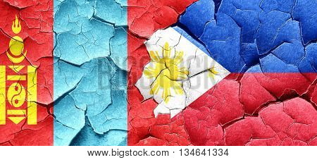 Mongolia flag with Philippines flag on a grunge cracked wall