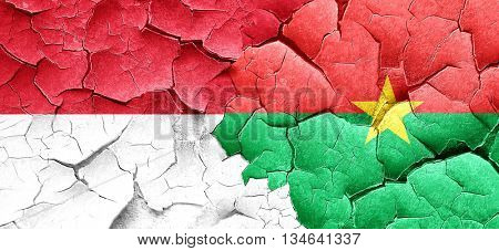monaco flag with Burkina Faso flag on a grunge cracked wall
