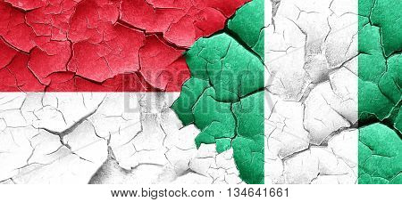 monaco flag with Nigeria flag on a grunge cracked wall