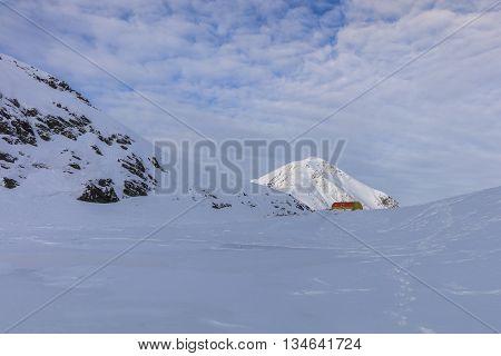 Caltun refuge in winter. Fagaras Mountains Romania