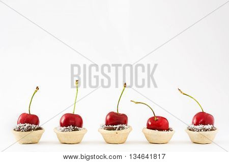 Delicious chocolate tartlets isolated on white background