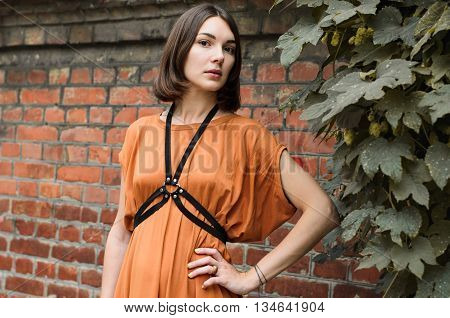 Beautiful girl in a long boho dress posing in the street