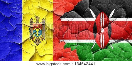 Moldova flag with Kenya flag on a grunge cracked wall