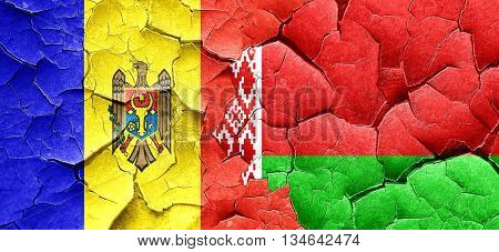 Moldova flag with Belarus flag on a grunge cracked wall
