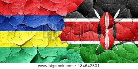 Mauritius flag with Kenya flag on a grunge cracked wall