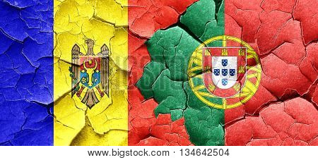 Moldova flag with Portugal flag on a grunge cracked wall