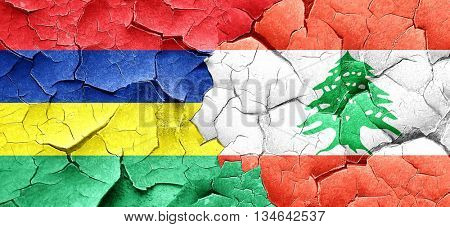 Mauritius flag with Lebanon flag on a grunge cracked wall