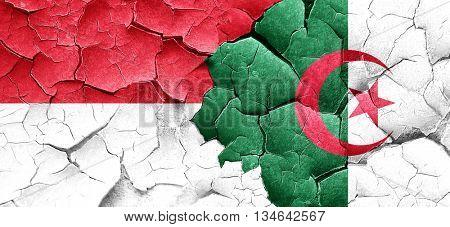 monaco flag with Algeria flag on a grunge cracked wall