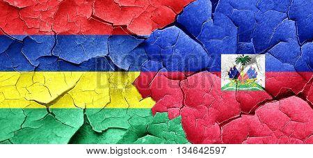 Mauritius flag with Haiti flag on a grunge cracked wall