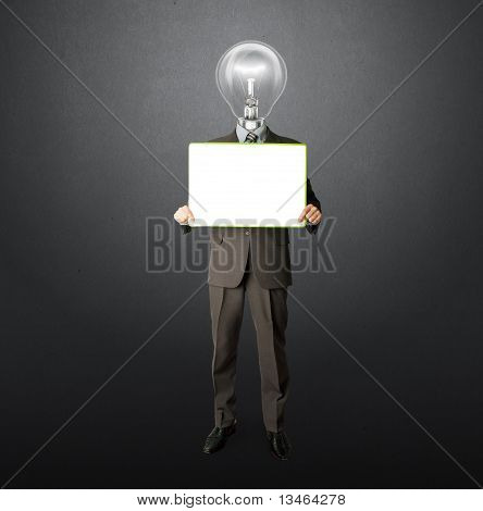 Happy Businessman With Lamp-head Holding Card