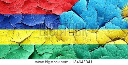 Mauritius flag with rwanda flag on a grunge cracked wall