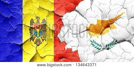 Moldova flag with Cyprus flag on a grunge cracked wall