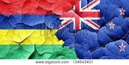 Mauritius flag with New Zealand flag on a grunge cracked wall