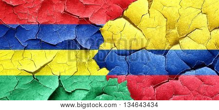 Mauritius flag with Colombia flag on a grunge cracked wall