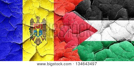 Moldova flag with Palestine flag on a grunge cracked wall