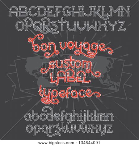 Custom retro typeface Bon Voyage. Vintage alphabet font set on the dark background and world map ribbon scroll