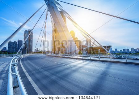 modern buildings with empty road under blue sky,tianjin china.