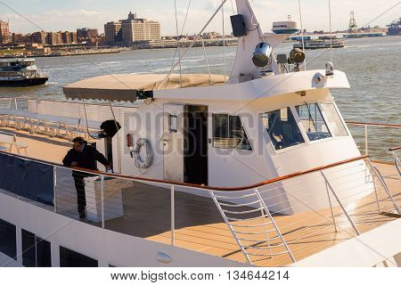NEW YORK - MARCH 17, 2016: Hornblower Serenity near Pier 15 at daytime. Pier 15 is located east of South Street and FDR Drive in Lower Manhattan, New York City.