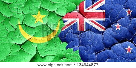 Mauritania flag with New Zealand flag on a grunge cracked wall