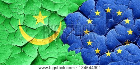 Mauritania flag with european union flag on a grunge cracked wal