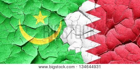 Mauritania flag with Bahrain flag on a grunge cracked wall