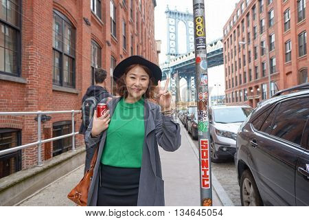 NEW YORK - CIRCA MARCH, 2016: outdoor lifestyel portrait of woman in Brooklyn, New York. The City of New York is the most populous city in the United States