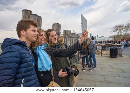 NEW YORK - CIRCA MARCH, 2016: outdoor lifestyle portrait of people taking selfie in New York. The City of New York is the most populous city in the United States