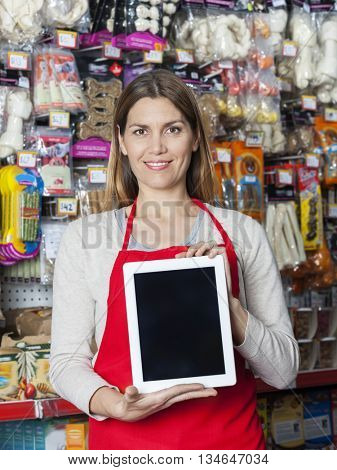 Smiling Saleswoman Showing Digital Tablet In Pet Store