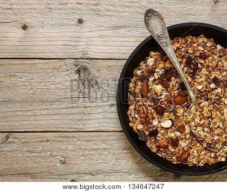 Homemade granola with raisins walnuts almonds and hazelnuts. Muesli. Healthy Breakfast. Top view. Copy space