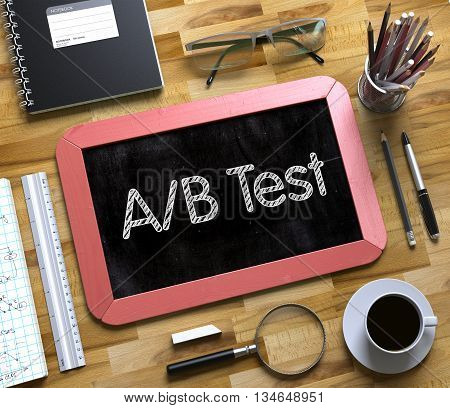 Top View of Office Desk with Stationery and Red Small Chalkboard with Business Concept - AB Test. AB Test Handwritten on Small Chalkboard. 3d Rendering.