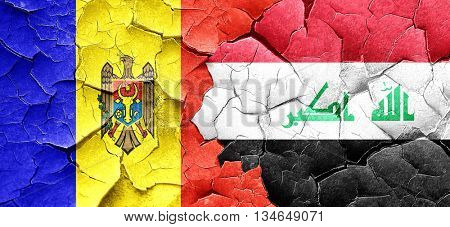 Moldova flag with Iraq flag on a grunge cracked wall