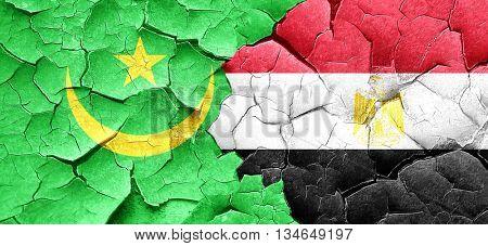 Mauritania flag with egypt flag on a grunge cracked wall