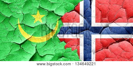 Mauritania flag with Norway flag on a grunge cracked wall