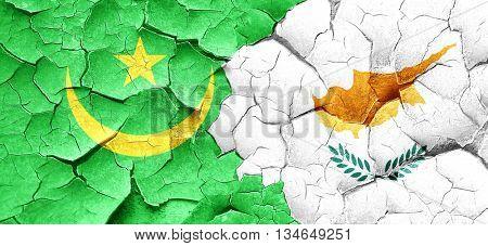 Mauritania flag with Cyprus flag on a grunge cracked wall