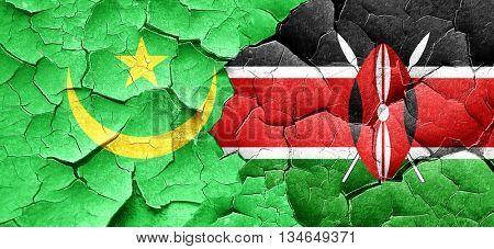 Mauritania flag with Kenya flag on a grunge cracked wall