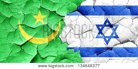 Mauritania flag with Israel flag on a grunge cracked wall